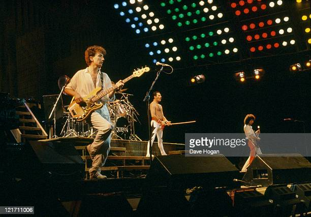 Queen performing at the Rock in Rio festival Brazil January 1985 From left to right bassist John Deacon singer Freddie Mercury and guitarist Brian May