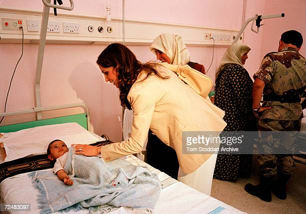 Queen Rania and sick child during a visit to a hospital Queen Rania AlAbdullah was born in Kuwait on August 31 1970 Queen Rania married King Abdullah...