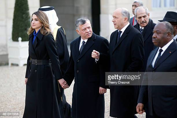 Queen Rania King Abdullah II of Jordan and Laurent Fabius French Minister of Foreign Affairs and International Development leave the Elysee Palace to...