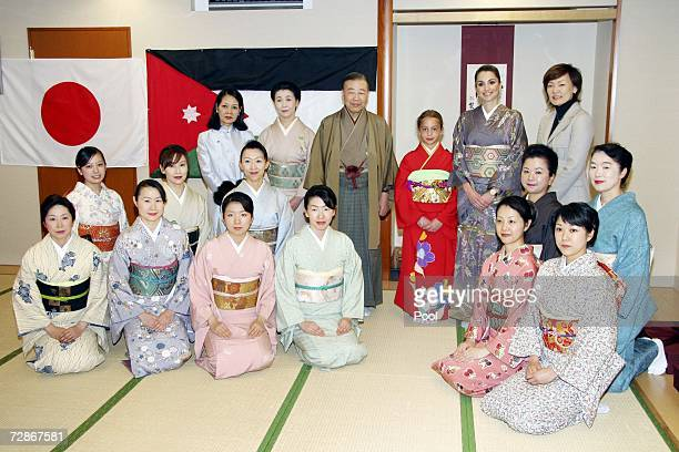Queen Rania of Jordan and daughter Princess Iman pose with Japan's First Lady Akie Abe students and teachers at the Sodo Kimono Academy on December...