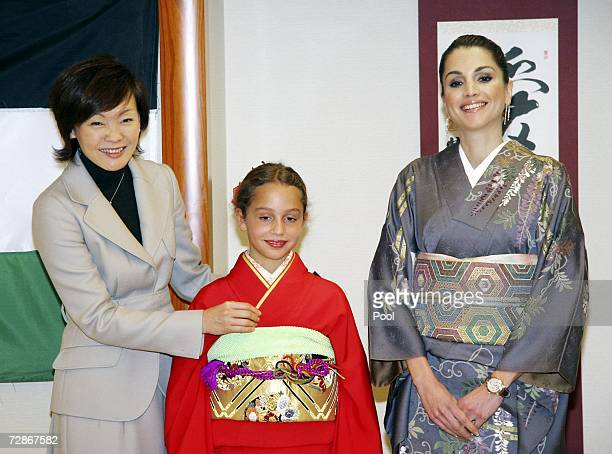 Queen Rania of Jordan and daughter Princess Iman pose with Japan's First Lady Akie Abe at the Sodo Kimono Academy on December 22 2006 in Tokyo Queen...