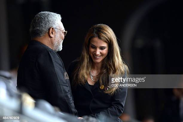 Queen Rania of Jordan and Ghana's former President Jerry Rawlings arrive for the memorial service of South African former president Nelson Mandela at...