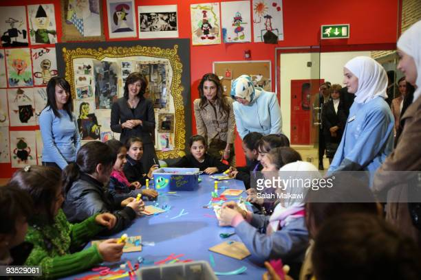 Queen Rania of Jordan and the Turkish President's wife Hayrunnisa Gul visit the Children's Museum on December 1 2009 in Amman Jordan