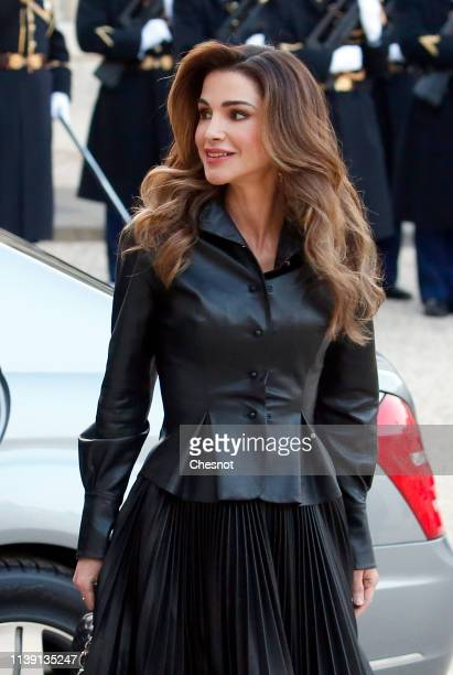 Queen Rania of Jordan arrives at the Elysee Presidential Palace for a meeting with French President Emmanuel Macron and his wife Brigitte Macron on...
