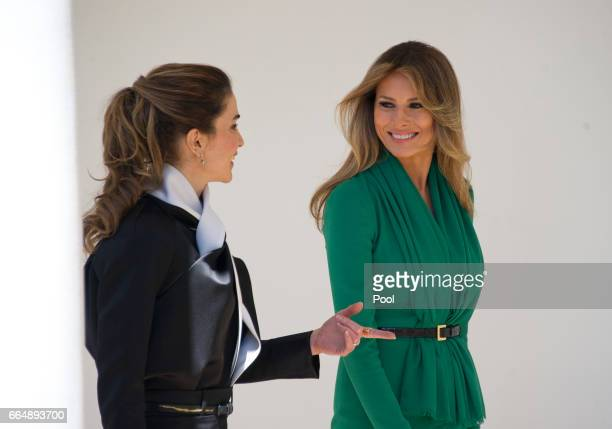 Queen Rania of Jordan left and first lady Melania Trump right walk along the Colonnade of the White House on April 5 2017 in Washington DC US...