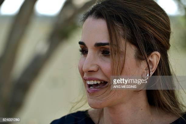 Queen Rania of Jordan looks on during her visit at the refugee site of Kara Tepe in Mytilene on April 25 2016 / AFP / ARIS MESSINIS