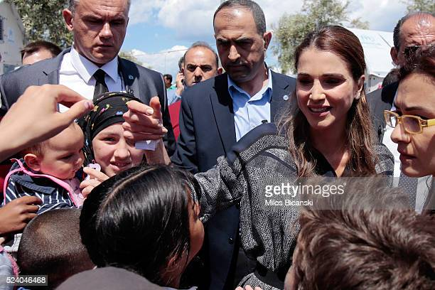 Queen Rania of Jordan meets Syrian refuges at the Karatepe municipality camp for refugees on the outskirts of Mytilene on April 25 2016 in Lesbos...