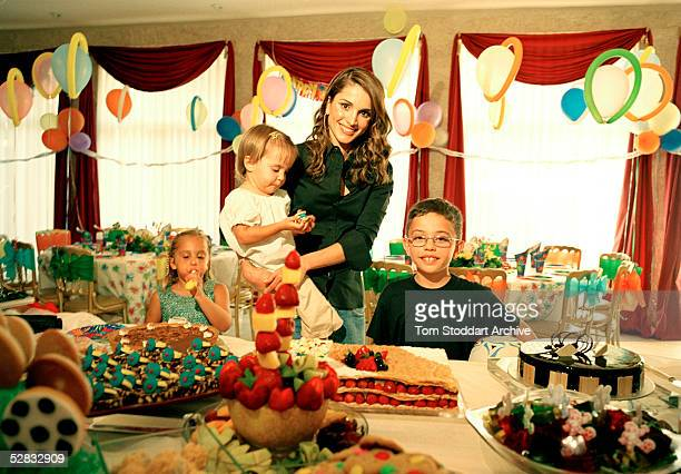 Queen Rania of Jordan photographed with with her children Princess Iman Princess Salma and Prince Hussein Queen Rania AlAbdullah was born in Kuwait...