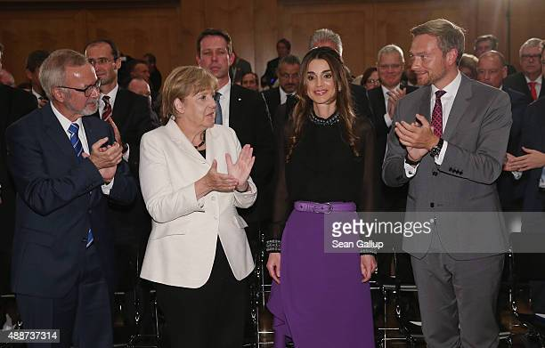 Queen Rania of Jordan smiles after receiving the Walther Rathenau Award from German Chancellor Angela Merkel as Walther Rathenau Institute Chairman...
