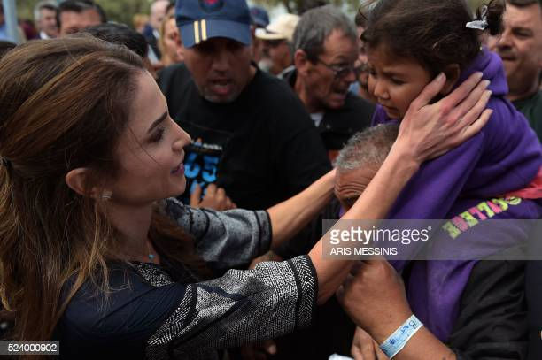 Queen Rania of Jordan speaks with refugees as she visits the refugee camp of Kara Tepe in Mytilene on April 25 2016 / AFP PHOTO / ARIS MESSINIS