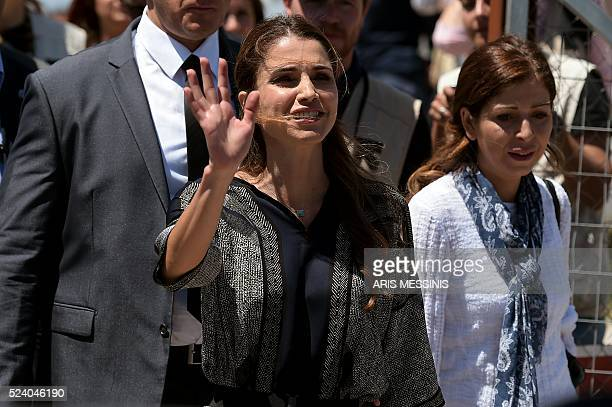 Queen Rania of Jordan waves after visiting at the refugee site of Kara Tepe in Mytilene on April 25 2016 Jordan's Queen Rania today called for...