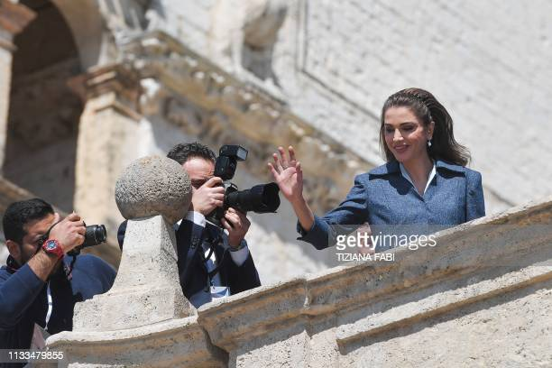 Queen Rania of Jordan waves upon her arrival for a ceremony at the Basilica of St. Francis of Assisi, on March 29, 2019 in Assisi, to hand the Lamp...
