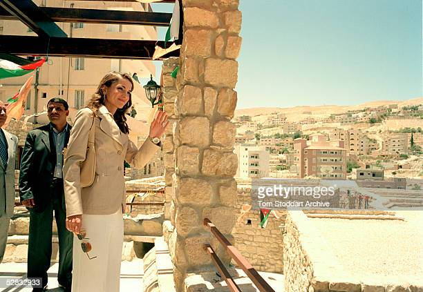 Queen Rania pictured during a visit to a tourist village at Petra in Jordan Queen Rania AlAbdullah was born in Kuwait on August 31 1970 Queen Rania...