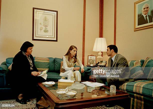 Queen Rania pictured with staff during a meeting at her office at the Ragadan Palace Queen Rania AlAbdullah was born in Kuwait on August 31 1970...