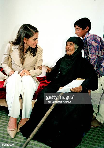 Queen Rania with a 90 year old woman pictured in the house she has built for her Queen Rania AlAbdullah was born in Kuwait on August 31 1970 Queen...