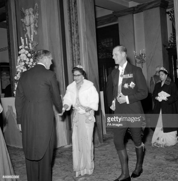 Queen Ratna of Nepal in pale blue and white chiffin is escorted by the Duke of Edinburgh courtly in kneebreeches as she arrives at the Royal Opera...