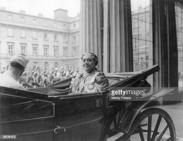 Queen Salote Tupou III of Tonga setting out from Buckingham Palace to Westminster Abbey for the Coronation of Elizabeth II Original Publication...