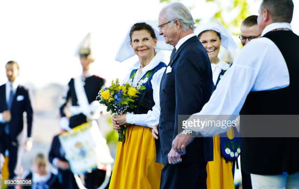 Queen Silvia and King Carl Gustaf stand together with crown princess Victoria and Prince Daniel at the National Day celebrations at Skansen in...