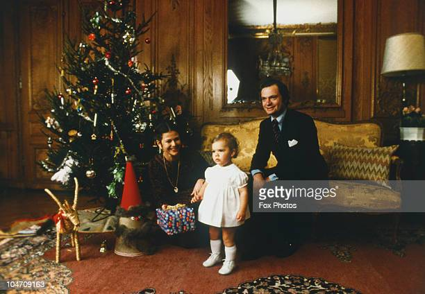 Queen Silvia and King Carl Gustaf XVI with young Princess Victoria celebrate Christmas at the Royal Palace in Stockholm in December 1978.