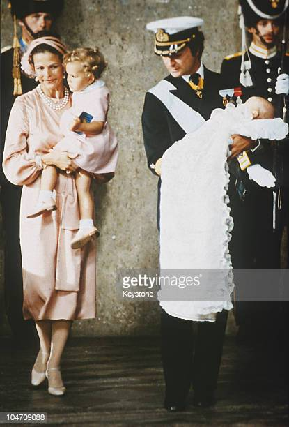 Queen Silvia and King Carl Gustav XVI of Sweden with Princess Victoria and baby Prince Carl Philip during his christening held at the Royal Chapel in...