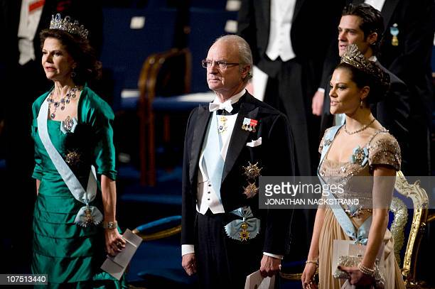 Queen Silvia King Carl XVI Gustaf and Crown Princess Victoria of the Swedish royal family attend the Nobel Prize award ceremony at the Concert Hall...