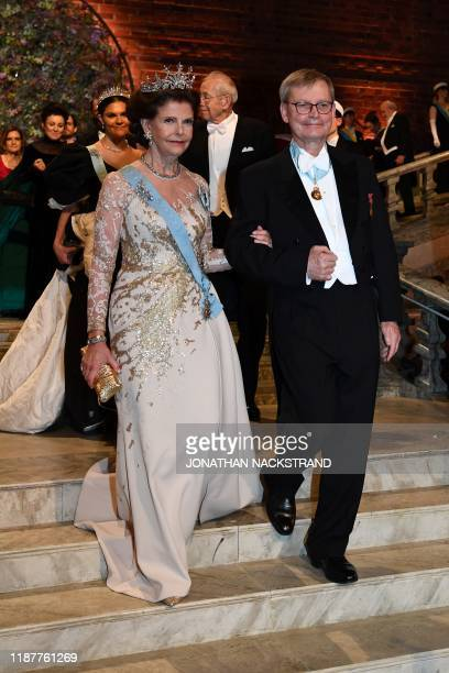 Queen Silvia of Sweden and CarlHenrik Heldin chairman of the Board of the Nobel foundation arrive for a royal banquet to honour the laureates of the...