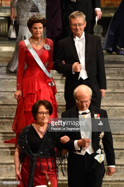 Queen Silvia of Sweden and Chairman of the Board of the Nobel Foundation Professor CarlHenrik Heldin and King Carl Gustaf XIV of Sweden and his...