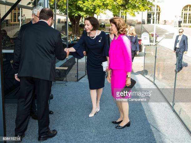 Queen Silvia of Sweden and Finnish first lady Jenni Haukio attend an art exhibition marking Finnlands centenary at the Army Museum on August 24 2017...