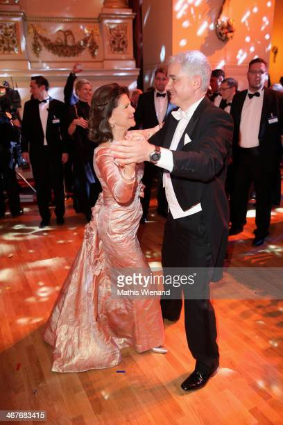 Queen Silvia of Sweden and Hans-Joachim Frey attend the Semper Opera Ball at Semperoper on February 7, 2014 in Dresden, Germany.