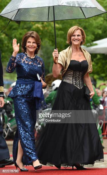 Queen Silvia of Sweden and Karin Seehofer arrive at the Festival Theatre on July 25 in Bayreuth southern Germany ahead of the opening of Bayreuth's...
