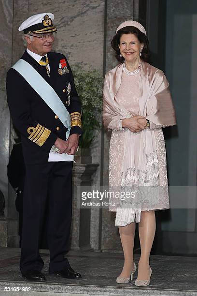 Queen Silvia of Sweden and King Carl Gustaf of Sweden are seen after the christening of Prince Oscar of Sweden at Royal Palace of Stockholm on May 27...