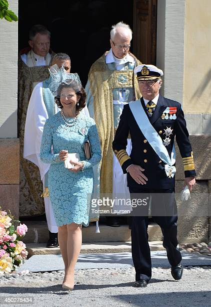 Queen Silvia of Sweden and King Carl Gustaf of Sweden arrive for Princess Leonore's Royal Christening at Drottningholm Palace Chapel on June 8 2014...