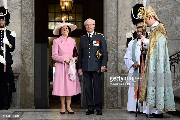 Queen Silvia of Sweden and King Carl XVI Gustaf arrive for the Te Deum thanksgiving service in the Royal Chapel during King Carl XVI Gustaf of...
