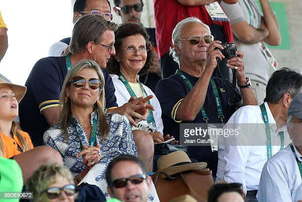 Queen Silvia of Sweden and King Carl XVI Gustaf of Sweden alongside Queen Maxima of the Netherlands attend the Jumping Individual Final on day 14 of...
