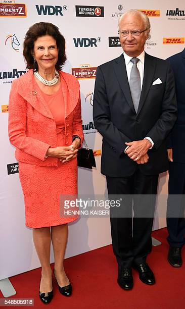 Queen Silvia of Sweden and King Carl XVI Gustaf of Sweden arrive for the media night on July 12 2016 in Aachen / AFP / dpa / Henning Kaiser / Germany...
