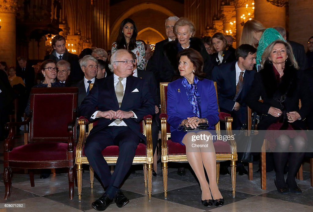 Queen Silvia of Sweden and King Carl XVI Gustaf of Sweden Attend The Sainte Lucie Concert At Notre Dame In Paris