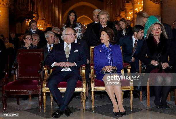 Queen Silvia of Sweden and King Carl XVI Gustaf of Sweden attend the Sainte Lucie concert at Notre-Dame de Paris on November 06 in Paris, France.