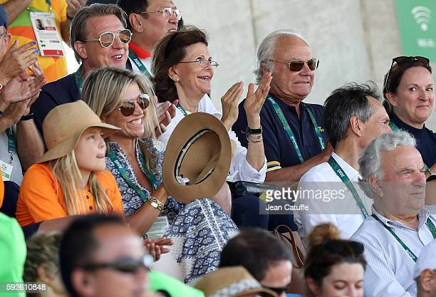 Queen Silvia of Sweden and King Carl XVI Gustaf of Sweden celebrate the silver medal of swedish rider Peder Fredricson while Queen Maxima of the...