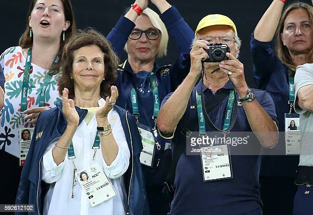 Queen Silvia of Sweden and King Carl XVI Gustaf of Sweden celebrate the silver medal of Sweden following the Women's Soccer FInal between Germany and...