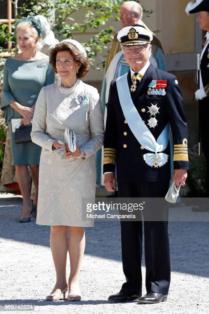 Queen Silvia of Sweden and King Carl XVI Gustaf of Sweden leave the christening of Princess Adrienne of Sweden at Drottningholm Palace Chapel on June...