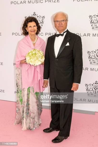 Queen Silvia of Sweden and King Carl XVI Gustaf of Sweden pose on the red carpet during the 2019 Polar Music Prize award ceremony on June 11, 2019 in...