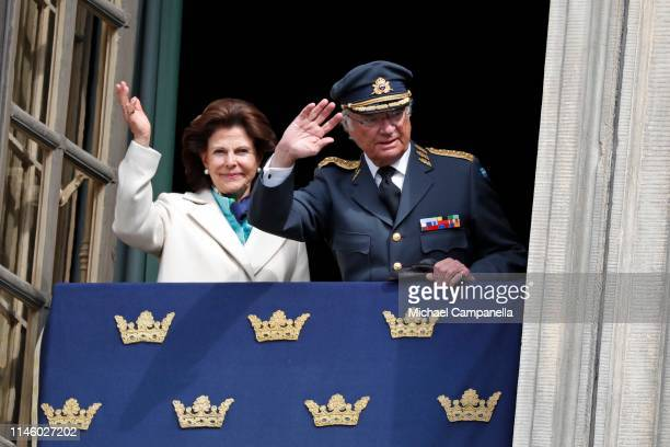 Queen Silvia of Sweden and King Carl XVI Gustaf of Sweden wave at the crowd during a celebration of King Carl Gustav's 73rd birthday anniversary at...