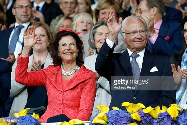 Queen Silvia of Sweden and King Carl XVI Gustaf of Sweden wave to the crowd during the opening ceremony of the CHIO 2016 on July 12 2016 in Aachen...