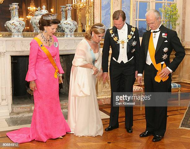 Queen Silvia of Sweden and King Carl XVI Gustaf welcomes Grand Duchess Maria Teresa and Grand Duke Henri of Luxembourg to a state banquet at the...