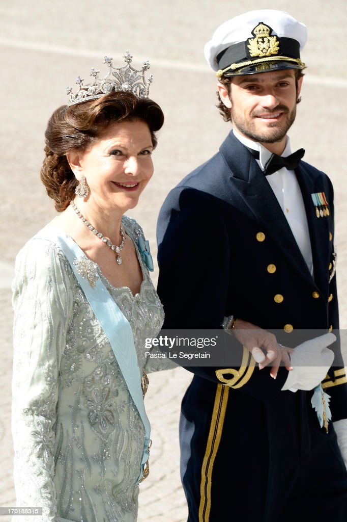 Queen Silvia of Sweden and Prince Carl Philip of Sweden attend the wedding of Princess Madeleine of Sweden and Christopher O'Neill hosted by King Carl Gustaf XIV and Queen Silvia at The Royal Palace on June 8, 2013 in Stockholm, Sweden.