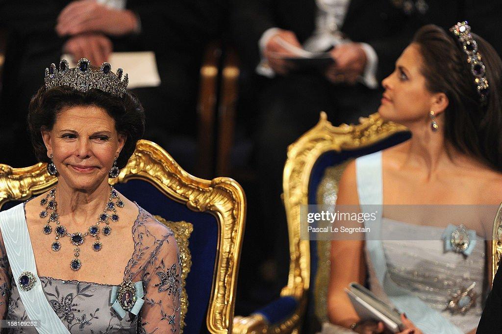Queen Silvia of Sweden (L) and Princess Madeleine of Sweden attend the 2012 Nobel Prize Award Ceremony at Concert Hall on December 10, 2012 in Stockholm, Sweden.