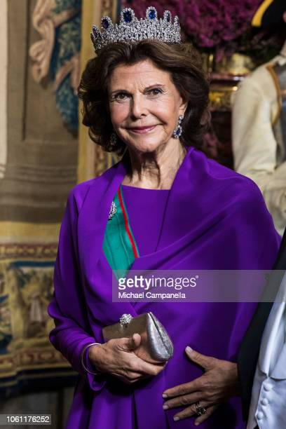 Queen Silvia of Sweden arrives at a gala dinner hosted by the Swedish royal family in connection with the state visit from the Italian president at...
