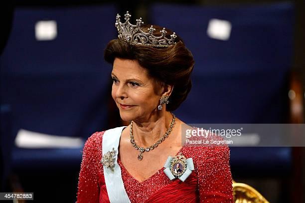 Queen Silvia of Sweden attends the Nobel Prize Awards Ceremony at Concert Hall on December 10, 2013 in Stockholm, Sweden.