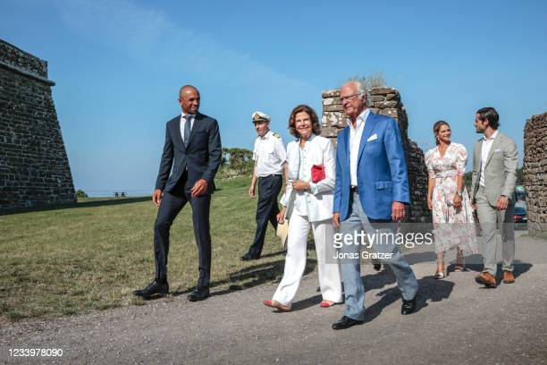 Queen Silvia of Sweden, Carl XVI Gustaf, King of Sweden, Princess Madeleine of Sweden and Prince Carl Philip, Duke of Varmland are seen on the...