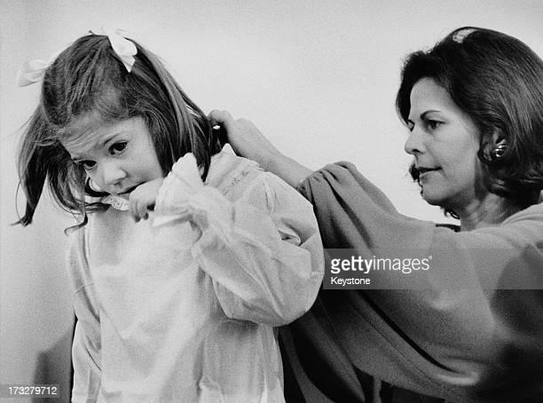 Queen Silvia of Sweden dresses her daughter Crown Princess Victoria of Sweden 1984